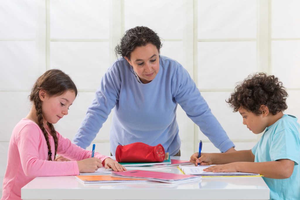 Children doing homework. (Photo by: BSIP/UIG via Getty Images)