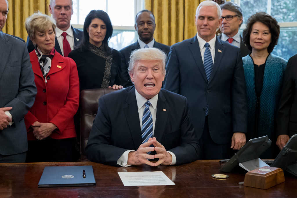 U.S. President Donald J. Trump delivers brief remarks before signing an executive order entitled, 'Comprehensive Plan for Reorganizing the Executive Branch', beside members of his Cabinet in the Oval Office of the White House on March 13, 2017 (Photo by Michael Reynolds-Pool/Getty Images)