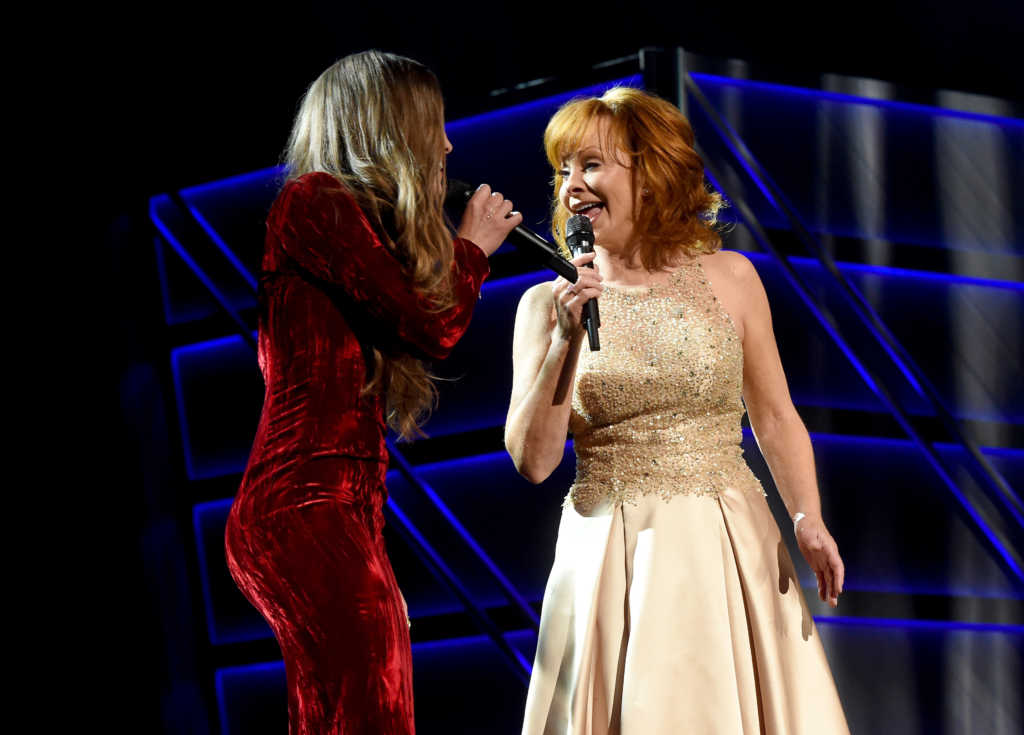 Recording artists Lauren Daigle (L) and Reba McEntire perform onstage during the 52nd Academy of Country Music Awards (Photo by Kevin Winter/ACMA2017/Getty Images for ACM)