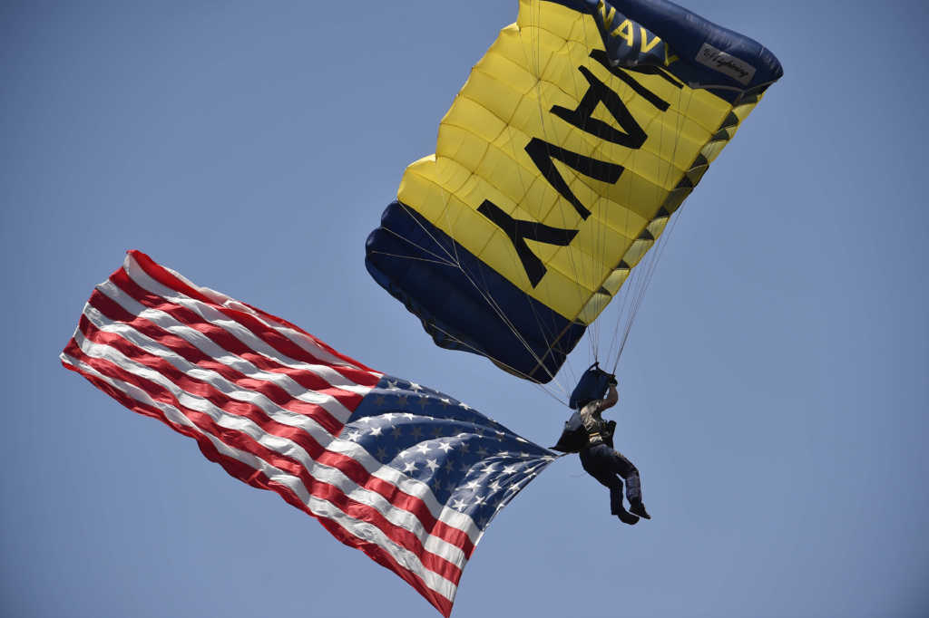 SAN DIEGO, CA - MAY 25: A member of the Navy Seals Leapfrogs parachute team lands on the field before a baseball game between San Diego Padres and the Chicago Cubs at Petco Park May 25, 2014 in San Diego, California. (Photo by Denis Poroy/Getty Images)