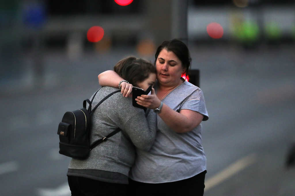 MANCHESTER, ENGLAND - MAY 23: Ariana Grande concert attendees Vikki Baker and her daughter Charlotte, aged 13, leave the Park Inn where they were given refuge after last night's explosion at Manchester Arena on May 23, 2017 in Manchester, England. An explosion occurred at Manchester Arena as concert goers were leaving the venue after Ariana Grande had performed. Greater Manchester Police have confirmed 19 fatalities and at least 50 injured. (Photo by Christopher Furlong/Getty Images)