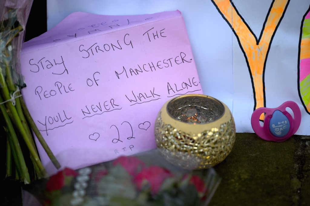 MANCHESTER, ENGLAND - MAY 23: Messages are left amongst tributes left by members of the public in St Ann Square on Tuesday, May 23, 2017 in Manchester,England. At least 22 people were killed in a suicide bombing at a pop concert packed with children in the northern English city of Manchester, in the worst terror incident on British soil since the London bombings of 2005.Ê (Photo by Jeff J Mitchell/Getty Images)
