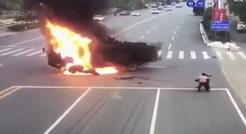 A explosion broke out in China after a motorcycle crashed into a dunk truck (Image source: Channel News Asia/Twitter)