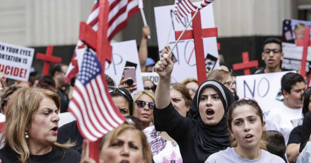 Demonstrators protest the arrest of Iraqi nationals by ICE agents outside of the Theodore Levin United States Courthouse, Wednesday, June 21, 2017 in Detroit, Michigan. (Photo credit: Junfu Han, Detroit Free Press)