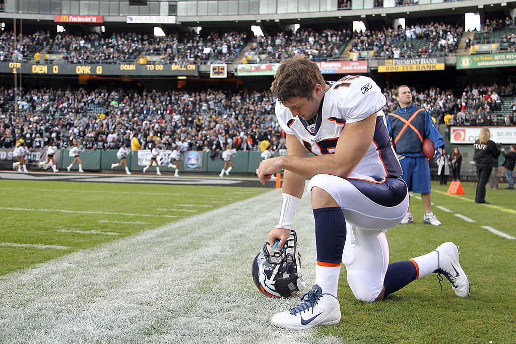 Back in 2011: Tim Tebow prays before s game against the Oakland Raiders (Photo credit: Ezra Shaw/Getty Images)