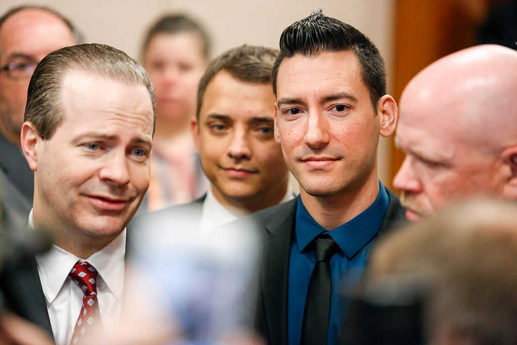 Attorney Jared Woodfill (L) speaks to the media alongside client David Daleiden (C), (Photo credit: Eric Kayne/Getty Images)