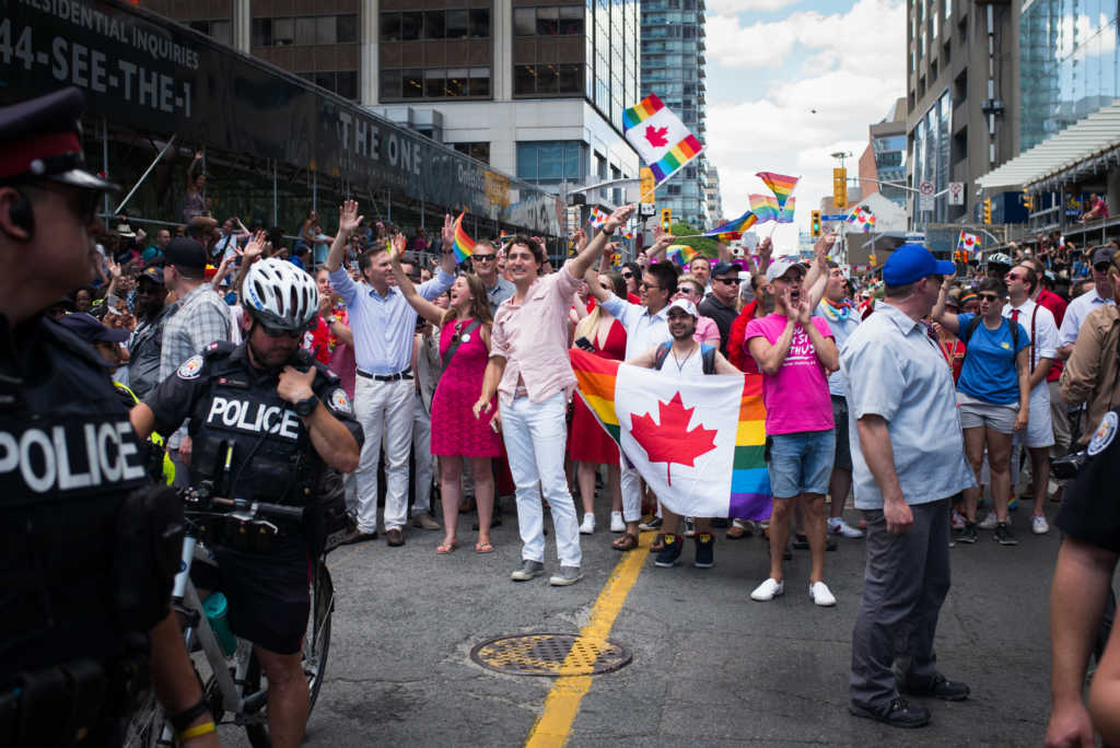TORONTO, CANADA - JULY 3: Canadian Prime Minister Justin Trudeau (middle, waving flag) participates at the annual Pride Festival parade, July 3, 2016 in Toronto, Ontario, Canada. Prime Minister Justin Trudeau will make history as the first Canadian PM to march in the parade. (Photo by Ian Willms/Getty Images)