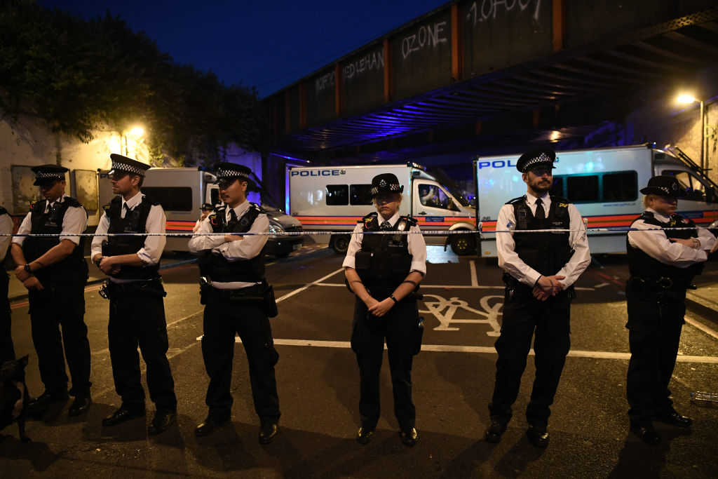 Police officers guard a road leading to Finsbury Park Mosque after an incident in which a van hit worshippers outside the building on June 19, 2017 in London, England. According to reports, worshippers were struck as they were leaving a mosque in North London after Ramadan prayers. (Carl Court/Getty Images)