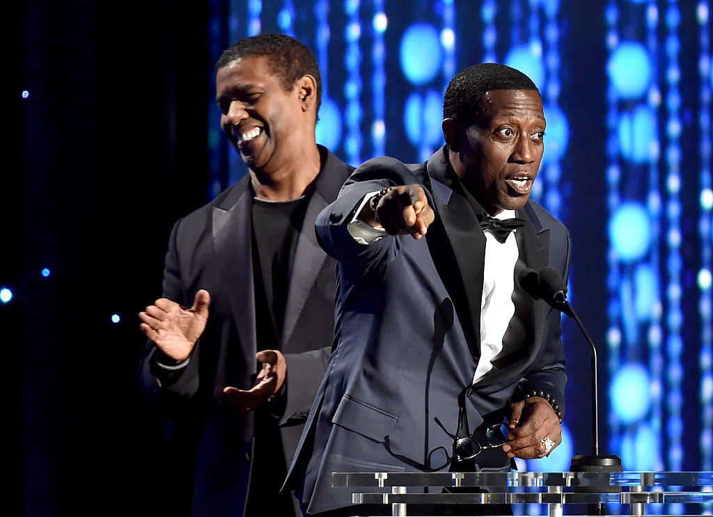 Actors Denzel Washington (L) and Wesley Snipes speak onstage during the Academy of Motion Picture Arts and Sciences' 7th annual Governors Awards at The Ray Dolby Ballroom at Hollywood & Highland Center on November 14, 2015 in Hollywood, California. (Photo by Kevin Winter/Getty Images)