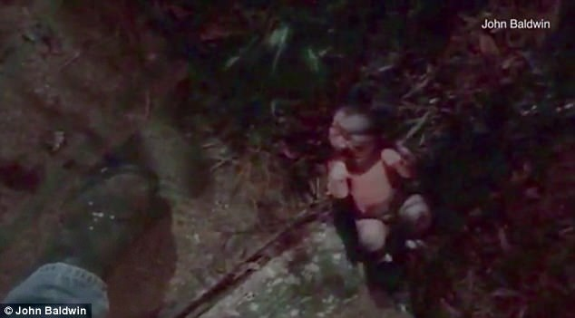 An screen grab from the video that shows the newborn abandoned in a flowerbed. (Photo Credit: James Baldwin)