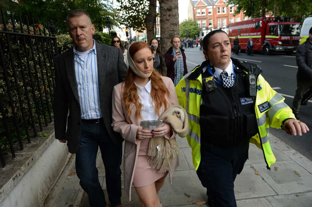A police officer escorts an injured woman from the scene at Parsons Green Underground Station on September 15, 2017 in London, England. Several people have been injured after an explosion on a tube train in south-west London. (Chris J Ratcliffe/Getty Images)