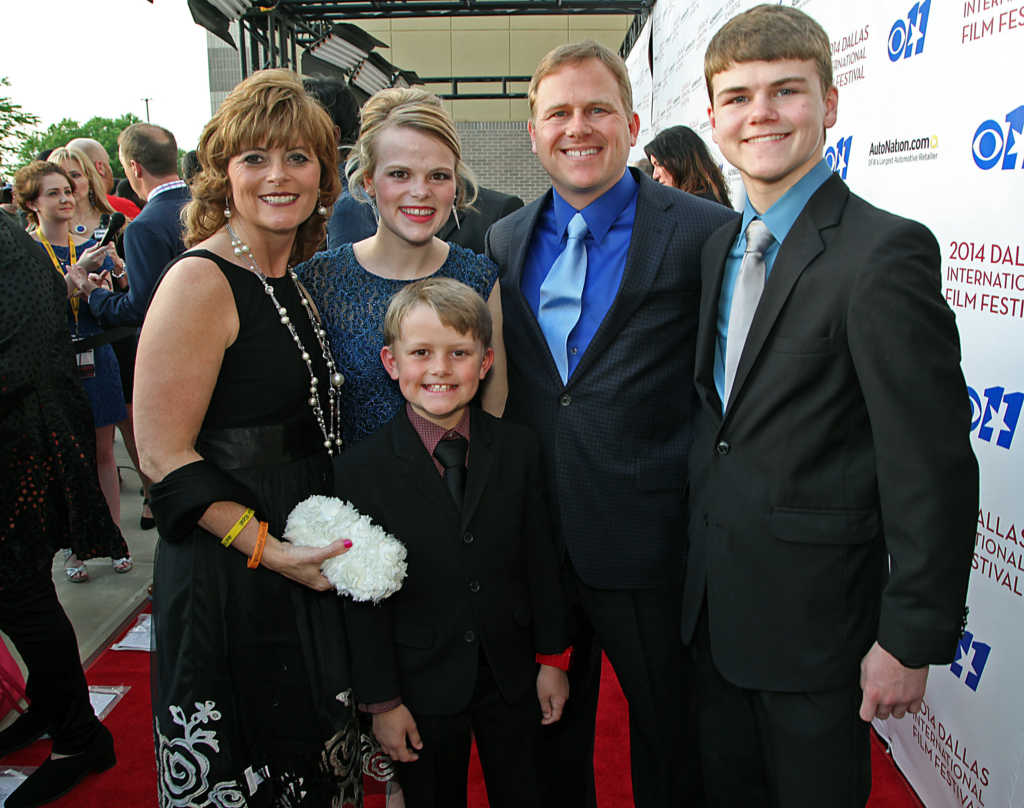 """The Burpo family, (L to R) Sonja, Cassie, Todd, Colton and Cole (front) attend the Dallas International Film Festival World Premiere of TriStar Pictures' """"Heaven Is For Real"""" at Cinemark West Plano, April 10, 2014 in Plano, Texas. (Stewart F. House/Getty Images for Sony Pictures Entertainment)"""