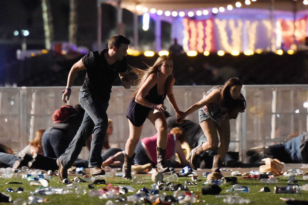 People run from the Route 91 Harvest country music festival after apparent gun fire was hear on October 1, 2017 in Las Vegas, Nevada. (David Becker/Getty Images)