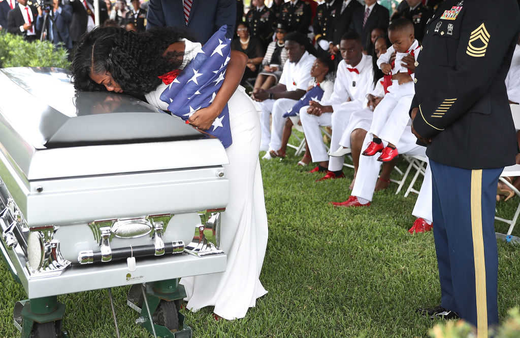 Myeshia Johnson kisses the casket of her husband U.S. Army Sgt. La David Johnson during his burial service at the Memorial Gardens East cemetery on October 21, 2017 in Hollywood, Florida. Sgt. Johnson and three other American soldiers were killed in an ambush in Niger on Oct. 4. (Joe Raedle/Getty Images)