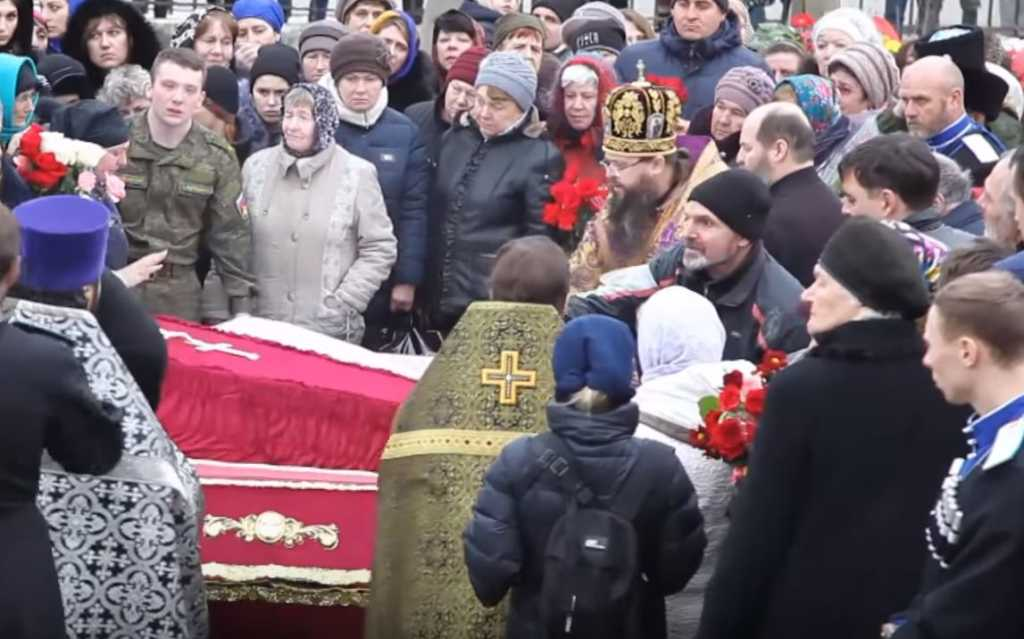 Friends and family mourn the dead after a shooting at a church in Russia's volatile Dagestan region. (Photo credit: (Photo credit: east2west news)