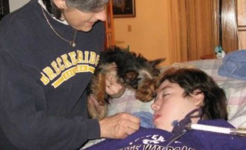Robbie Kramer (left) with her son, Keith, and their family dog in 2010. (Photo credit: Robbie Kramer)
