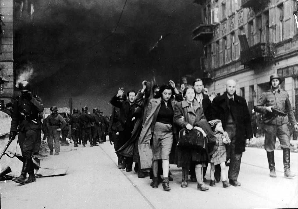 Captured Jewish civilians who participated in the Warsaw Ghetto Uprising are marched out of the city by Nazi troops, Warsaw, Poland, April 19, 1943. (Photo by Frederic Lewis/Getty Images)