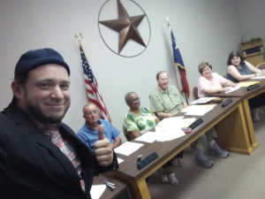 Pro-life campaigner Mark Lee Dickson with council members in Omaha, Texas.