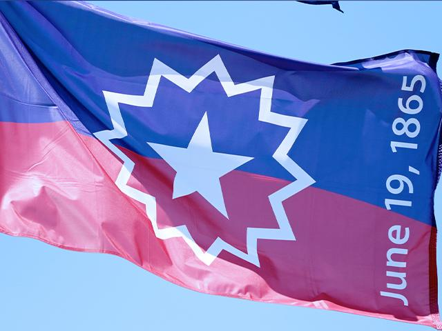 The Juneteenth flag, commemorating the day that slavery ended in the U.S., flies in Omaha, Neb., June 17, 2020. (AP Photo/Nati Harnik)